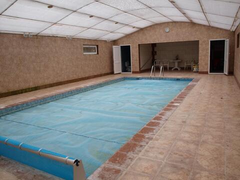 Коттедж с бассейном в охраняемом поселке бизнес класса