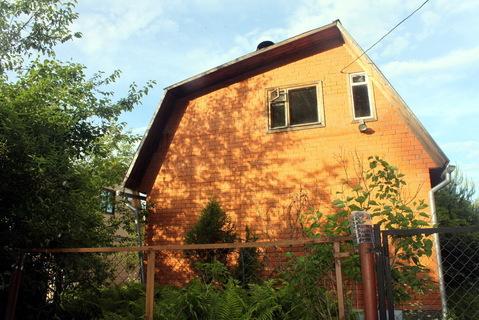 Дача у леса в Пыхчево. Теплый дом из бруса обложен кирпичом
