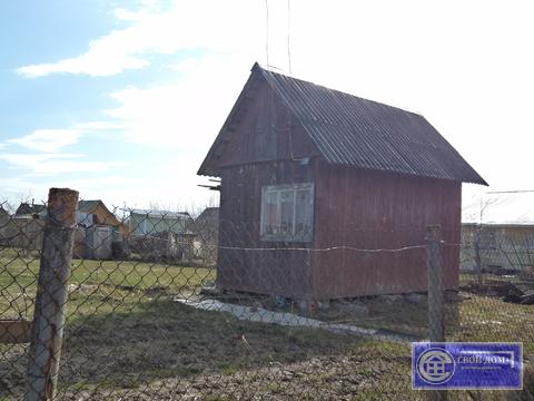 Участок с небольшим щитовым домиком в СНТ Горняк-2