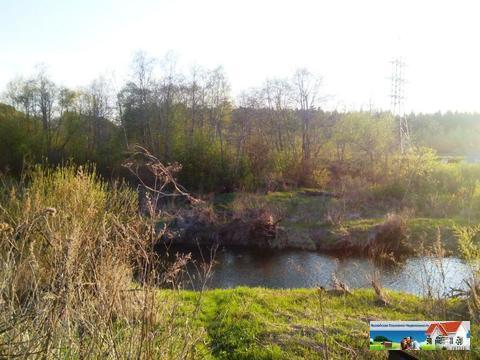 Участок 15 Га у реки с трех сторон лес.