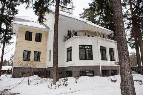 Роскошный дом площадью 700 кв.м, на участке 40соток