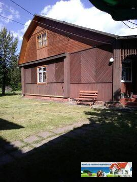 Рубленый дом из бревна на участке 15 соток.