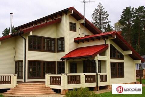 Роскошный деревянный дом в сосновом бору рядом с Подольском