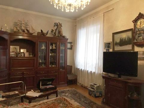 Продажа четырехкомнатной квартиры в центре Москвы