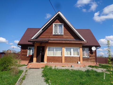 Бревенчатый дом на участке 20 соток в Сергиево-Посадском районе