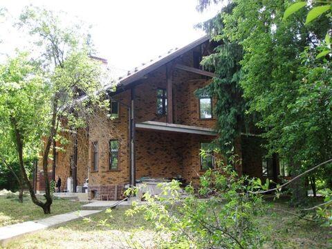 Солидный дом 540 м2, на лесном участке 22 соток в стародачном .