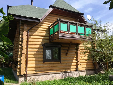 Добротный бревенчатый дом 100 кв. м из лиственницы с баней рядом с вдх