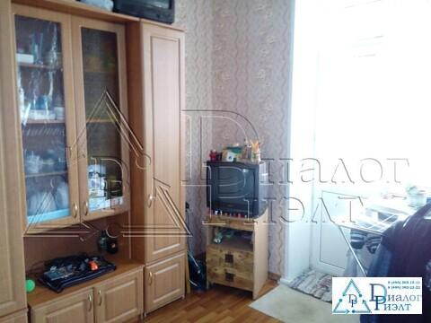 Продается комната в четырехкомнатной коммунальной квартире в п. Быково